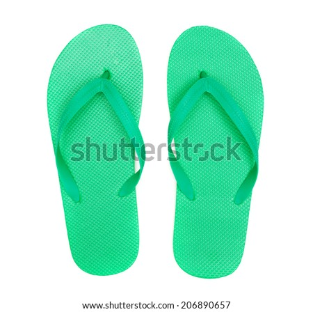 Green flip-flops isolated on white background - stock photo