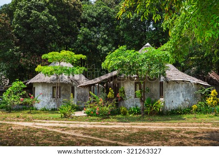Green forest and huts in a misty morning. Thailand - stock photo