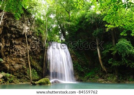 Green forest and water fall in raining season - stock photo