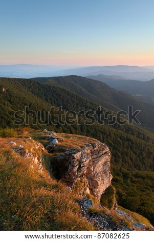 Green forest mountain at sunset with rocks. - High Tatras - stock photo