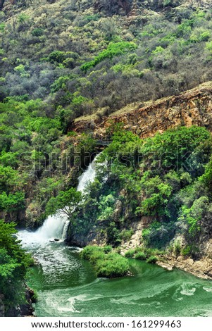 Green forest with waterfall in Africa - stock photo