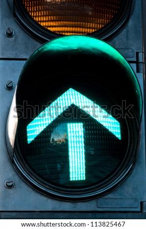 Green forward on the traffic light - stock photo