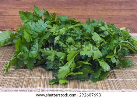 green fragrant parsley on straw - stock photo