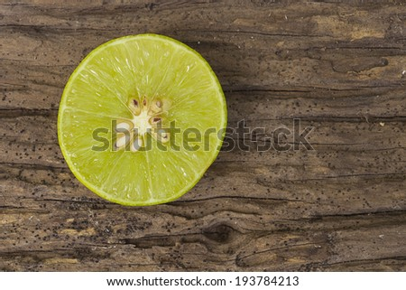 Green fresh lime on wooden table use for bacground - stock photo