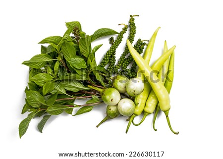 Green, Fresh peppers, peppercorn, eggplant, basil isolated on a white background. - stock photo
