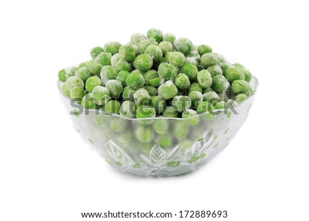 Green frozen peas. In a glass dish - stock photo
