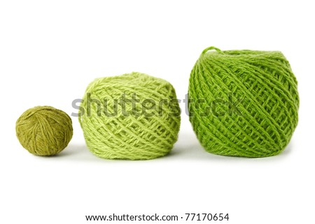 green gamma clews in a row, isolated - stock photo