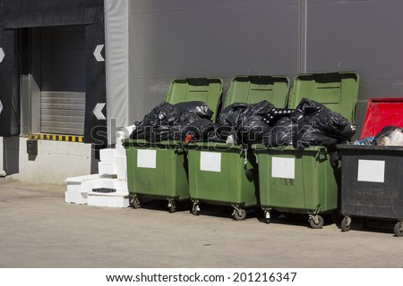 Green garbage containers  near large food city shop. Sunny day - stock photo