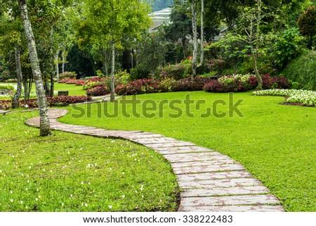 green garden, Landscaping in the garden. The path in the garden. - stock photo