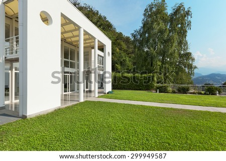 green garden of a white modern villa, external - stock photo