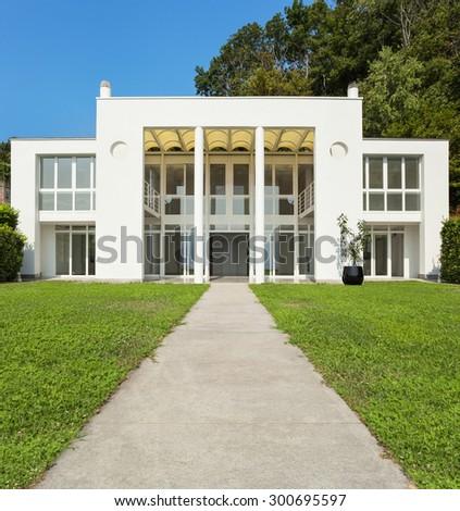 green garden of a white modern villa, external - stock photo