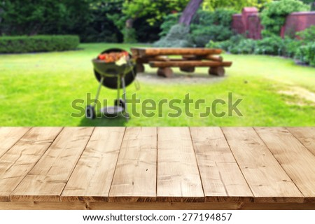 green garden of grill and free space on table  - stock photo