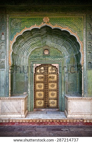 Green gate and golden door in City Palace of Jaipur, Rajasthan, India - stock photo