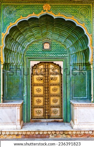 Green Gate in Pitam Niwas Chowk. Exterior of Jaipur City Palace, India. - stock photo