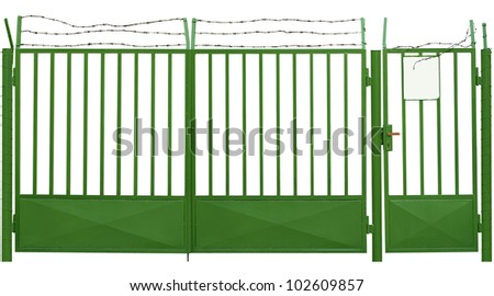 Green gate with barbed wire - stock photo