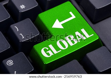 green global button on the black keyboard - stock photo