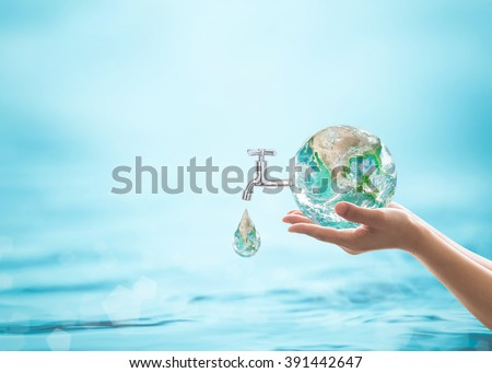 Green globe droplet fall on woman human hand from water tap blur blue sea ocean day background: World environmental protection: Saving aqua conceptual csr idea: Element of this image furnished by NASA - stock photo