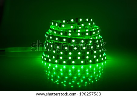 Green glowing LED garland, strip  - stock photo