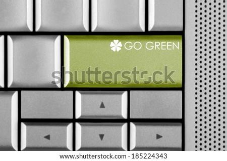 Green GO GREEN key on a computer keyboard  - stock photo