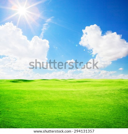 Green golf field under blue sky background - stock photo