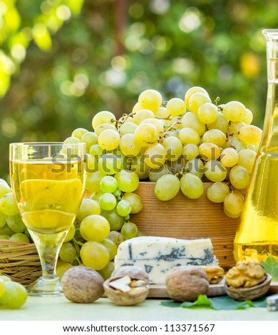 Green grapes and white wine - stock photo