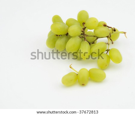 Green grapes on isolated white background - stock photo