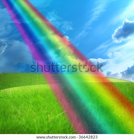 green grass and a blue sky with clouds - stock photo
