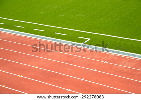 green grass and running lane - stock photo
