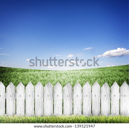 green grass and wood fence - stock photo