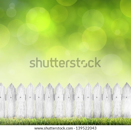 green grass and wood fence over bokeh  - stock photo