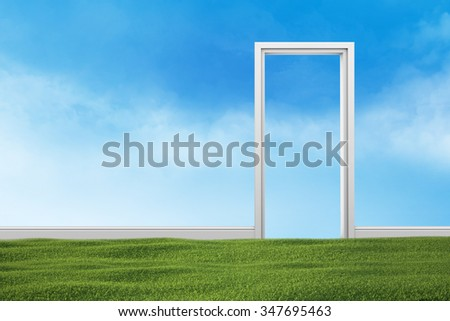 Green grass lawn in the room. The transparent wall with blue sky. - stock photo