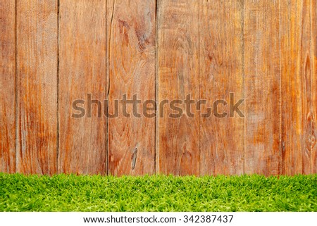 Green grass over wood background. - stock photo