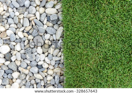 Green grass with Pebbles, Stone and grass in garden, grass with rock, Pebble with Grass, background - stock photo