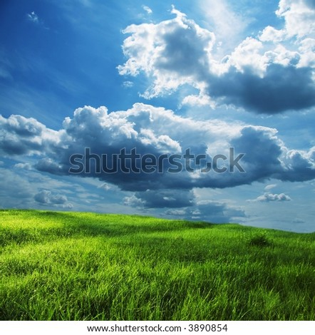 Green grassland and storm cloud - stock photo