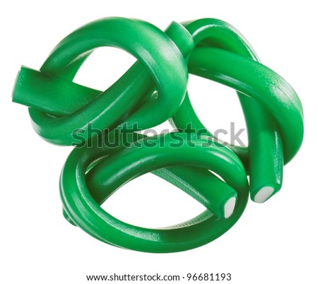 Green gummy candy (licorice) rope set, isolated on white closeup view - stock photo