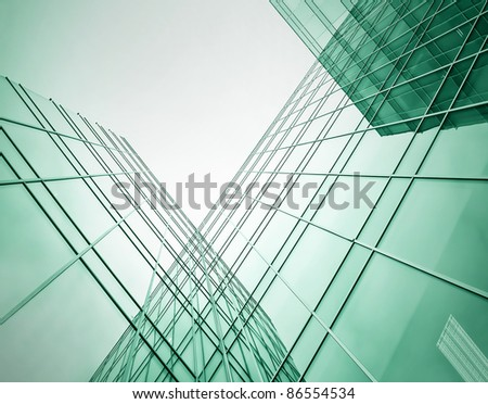 green high rise skyscrapers in the evening - stock photo