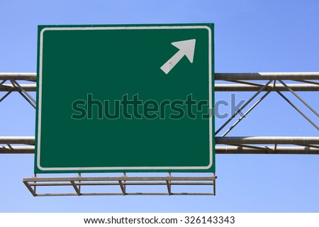 Green highway sign - stock photo