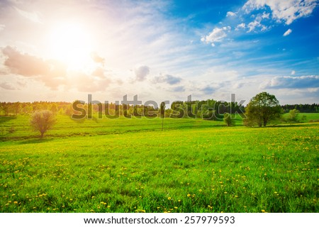 green hill and beautiful sunset - stock photo