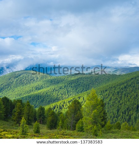 green hills and dense cloud sky - stock photo