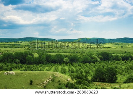 Green hills and meadows in the sky clouds storm clouds - stock photo