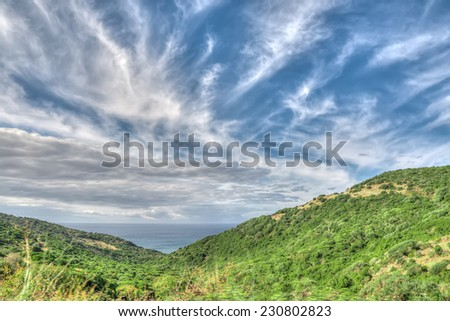 Green hills by Alghero shoreline, Italy. Heavy processed for hdr tone mapping effect. - stock photo
