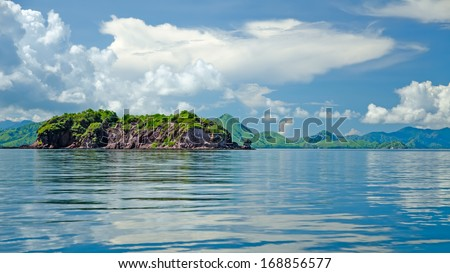 Green hills of the azure blue sea - stock photo