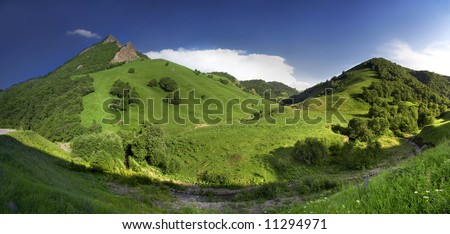 Green hills panorama - stock photo
