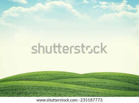 Green hills under bright sky. Nature concept - stock photo