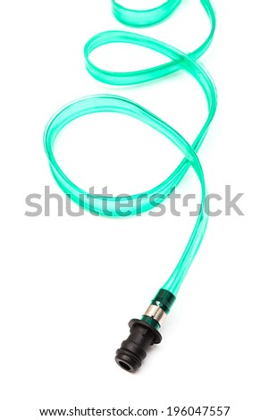 green hose on a white background - stock photo