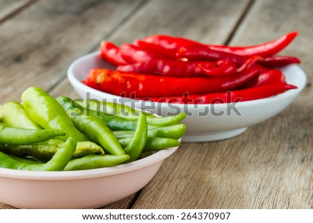 green hot chili paper in cup on old wooden table - stock photo