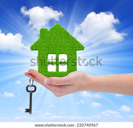 green house with key in hand  - stock photo