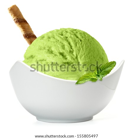 Green ice cream scoop in bowl on white background - stock photo