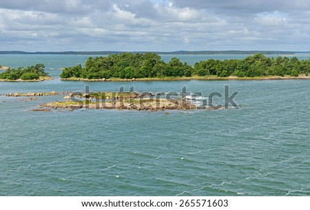 Green island in archipelago of Aland Islands, Finland - stock photo