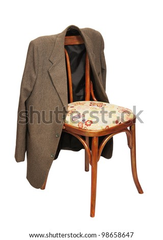 Green jacket hangs on a chair - stock photo